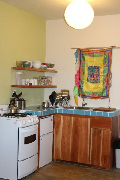 The kitchenette, though small, is fully equipped for cooking and dining.