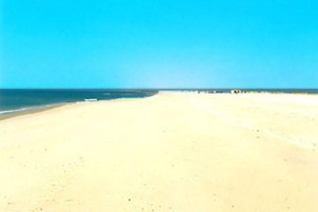 white sandy beach 5 km to the east