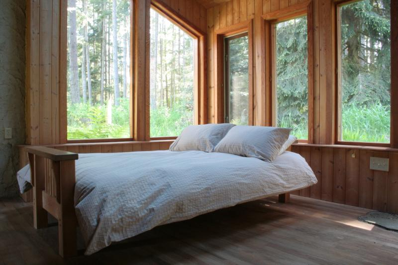 Forest room with queen bed.