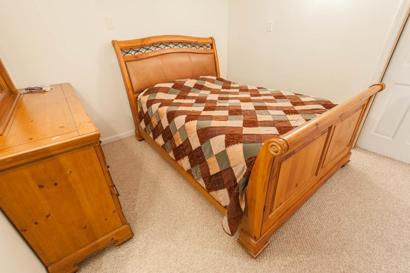 The Downstairs Bedroom with queen bed