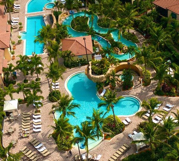 Ariel view of club swimming pools / lazy river hot tubs