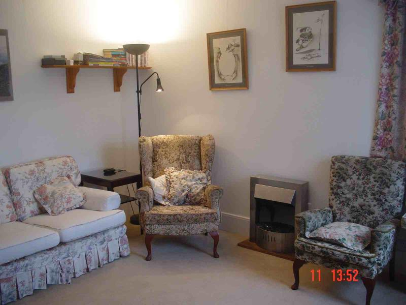 Holiday Cottage Flat on ground level situated in centre of highland village, vacation rental in Boat of Garten