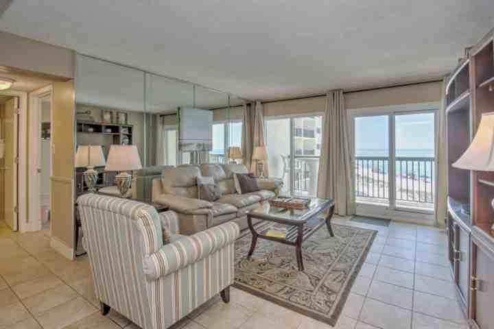 Living Room features sleeper sofa, flatscreen tv, and amazing gulf views!