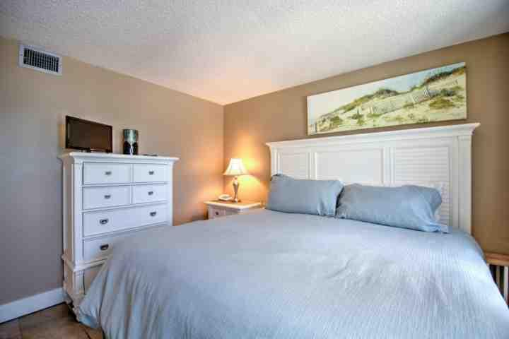 The KING SIZE BED in the master bedroom allows you to lie in bed and watch the sunrise over the Emerald Waters on Northwest Florida'a Gulf Coast