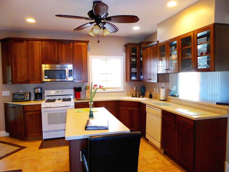 Fully stocked kitchen. New hickory cabinets and solid surface counter tops.