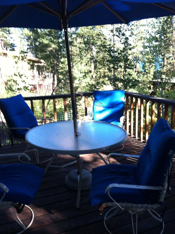 Umbrella table and swivel/rocking chairs on main deck.