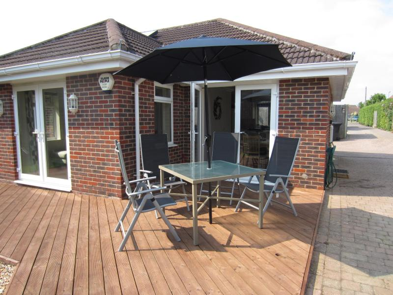 Patio doors from both dining area and sitting room for a lovely family summer outside living space