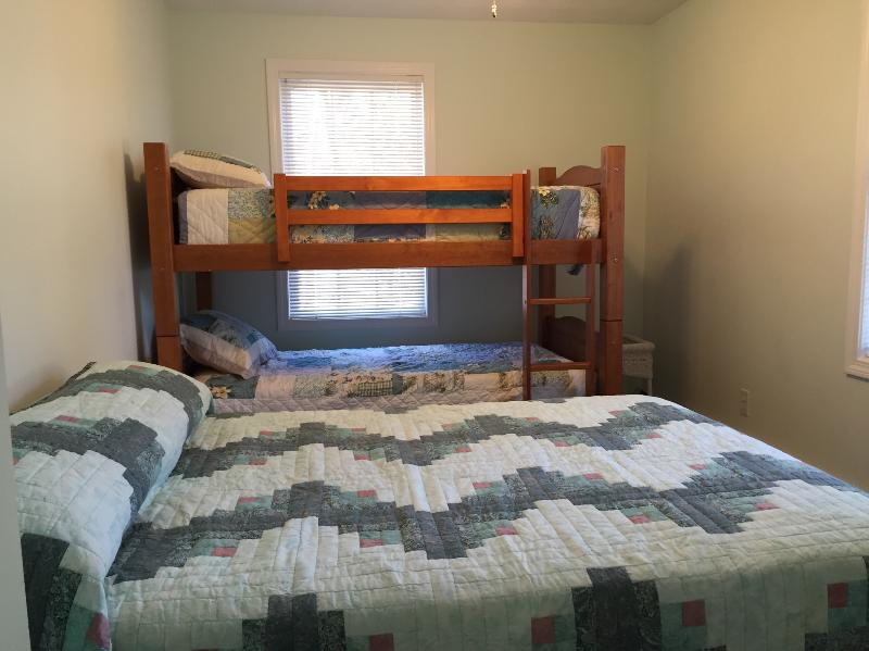 Bedroom with bunk beds and full size bed.