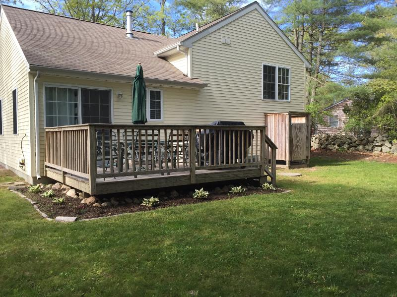 Deck has table and 6 chairs. The yard has a fire pit and outdoor shower.