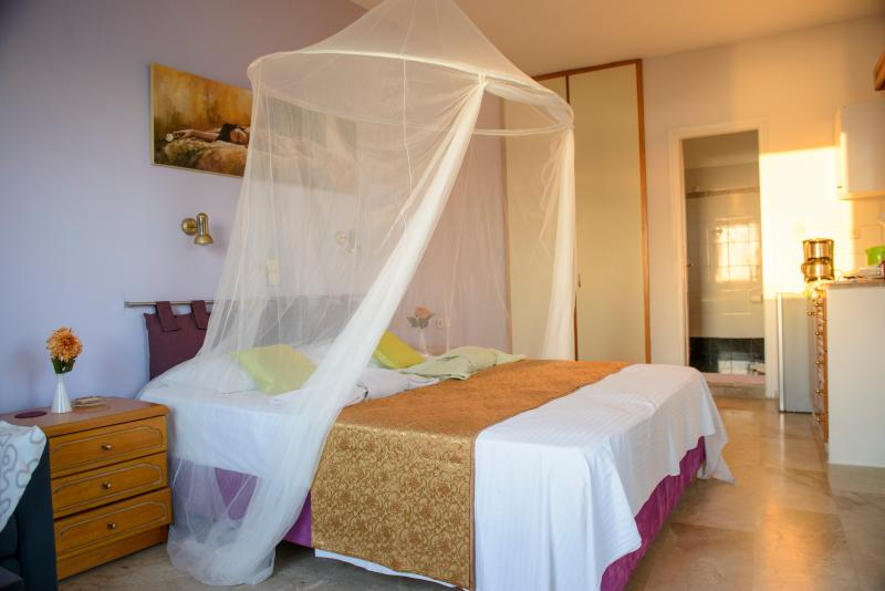 The brand newly king size bed of the honeymoon on the upper floor with private stair and balcony.