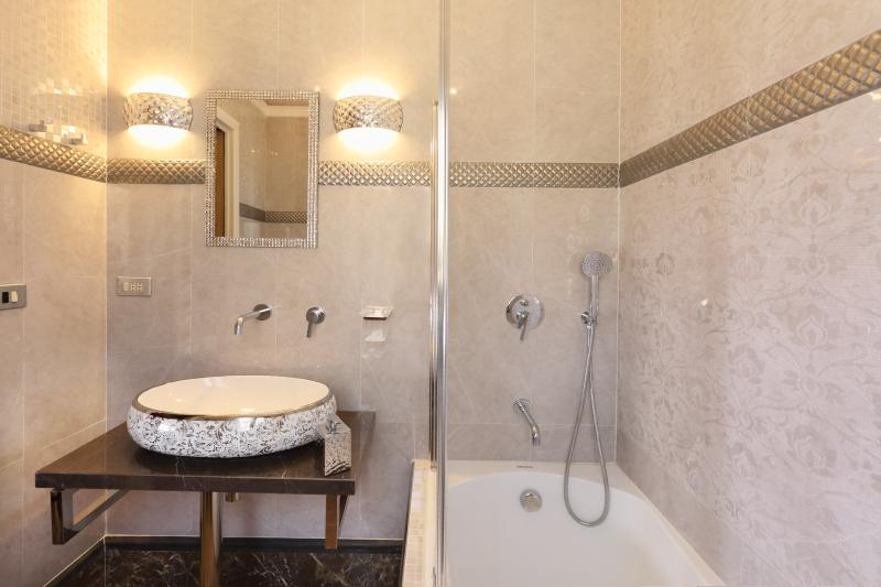 Deluxe ensuite bath room of master bed room with shower and bath tub