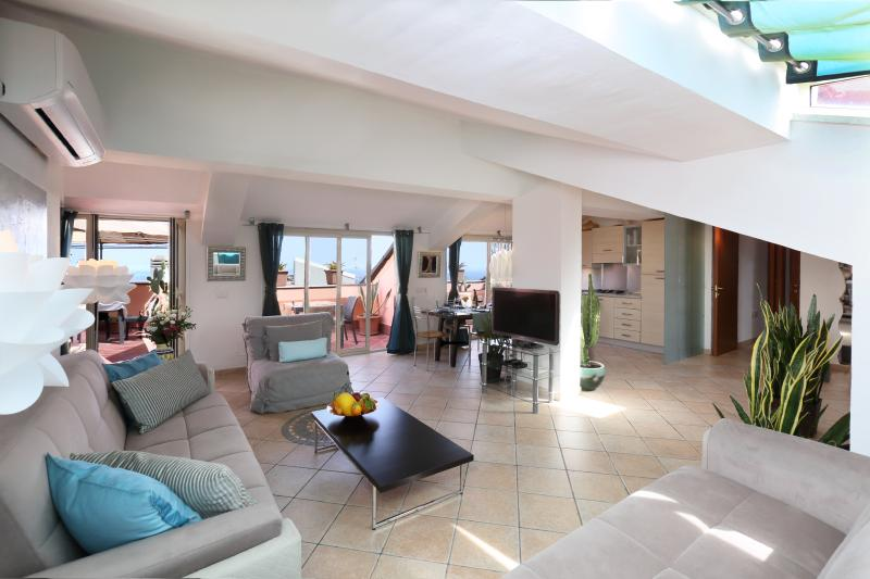 Open space living room 50 sqm large with stunning views on Mt. Etna, the historic city center of Tao