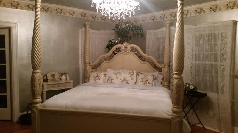 King pillowtop mattress, goose down pillows, and crystal chandelier