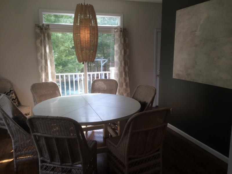 Formal dining room opens to deck.