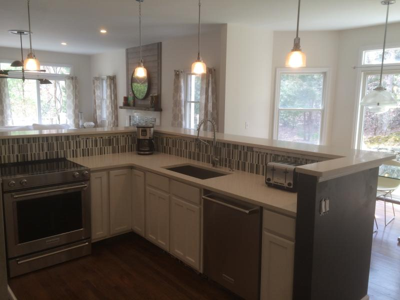 Large new kitchen open to family room and dining area with doors to back yard.