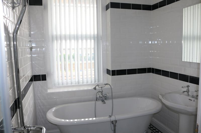 A Victorian Style Bathroom With A Sea View.
