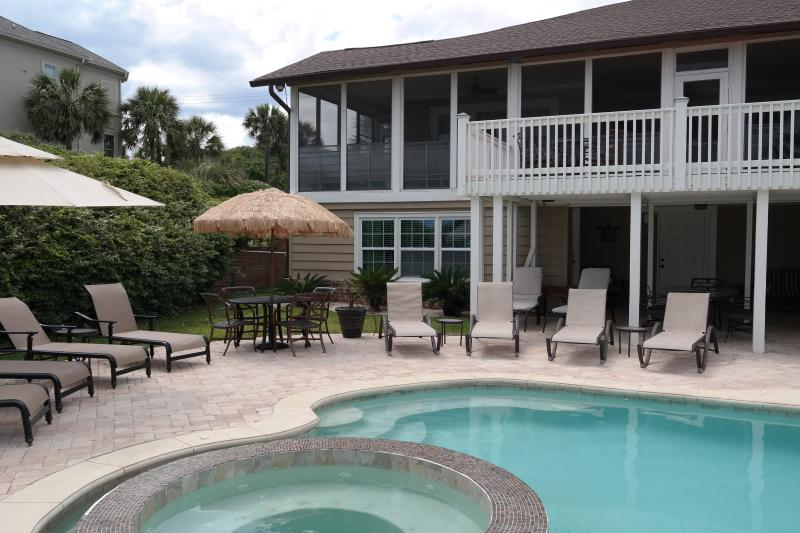 Rear patio leads to lower level bedrooms, bathrooms, steam room & kitchenette