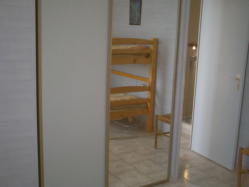 3rd bedroom with twin beds and bunk beds upstairs