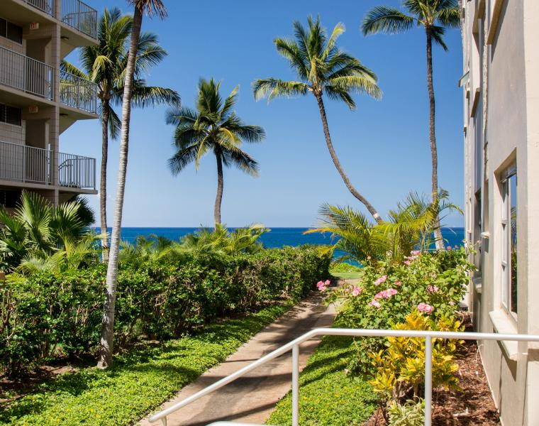 Our 2 Bedroom / 2 Bath ground floor condo has a partial ocean view from the Lanai and Master Bedroom