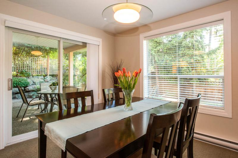 bright dining room with sliding door to private patio