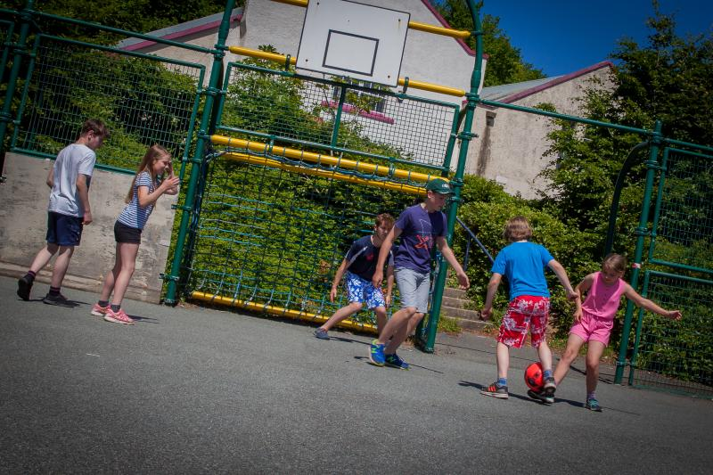Outdoor area with 5 a side football, basket ball and outdoor table tennis.