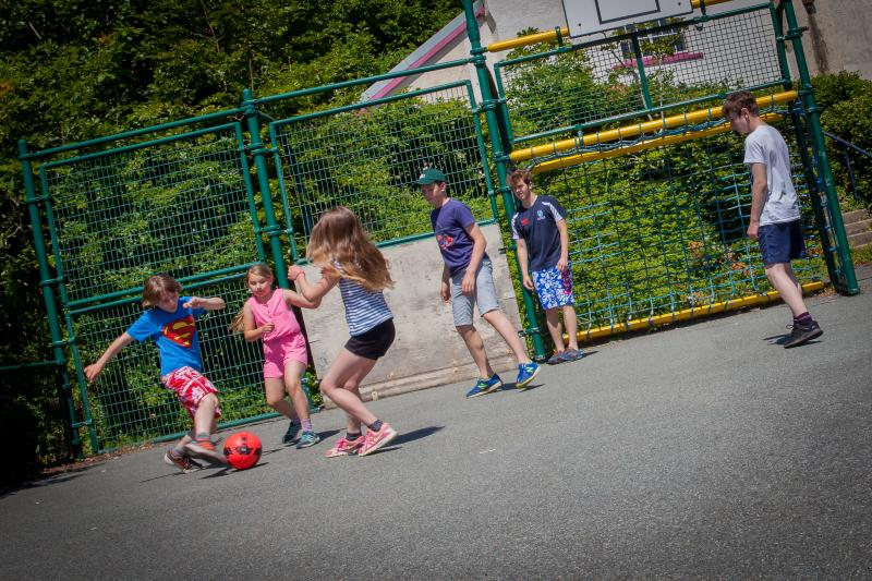 Kids play while you relax or challenge them to a game of footie!