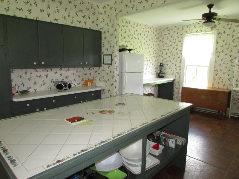 Large kitchen with two refrigerators and two ovens