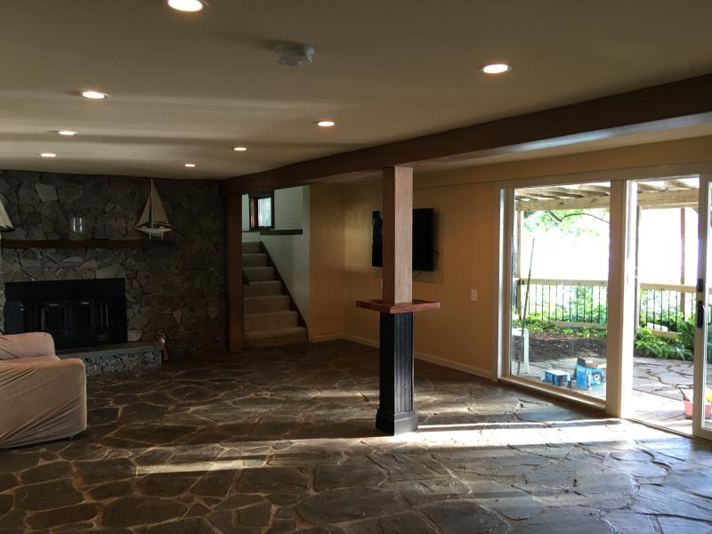 Ground level living space opens up to hot tub patio area.
