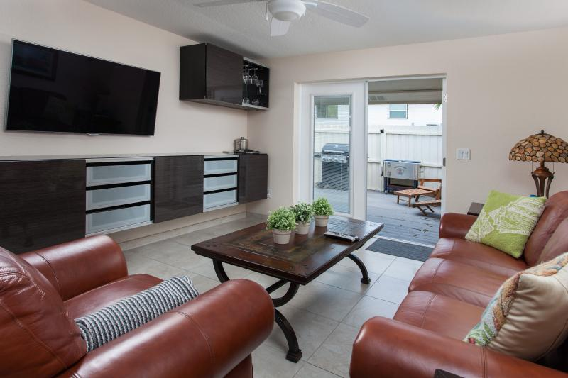 Living Area with French Doors to Private Enclosed Deck