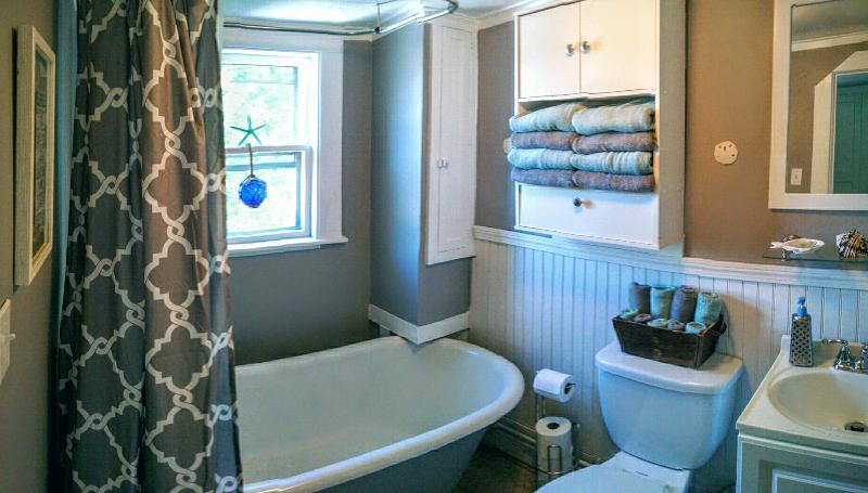 Bathroom, off the kitchen, with claw foot tub and shower.
