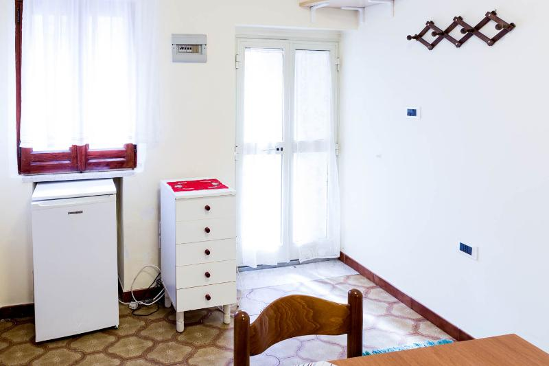 Entrance of the apartment, out the door a few steps away is the Greek Theater and the Corso Umberto