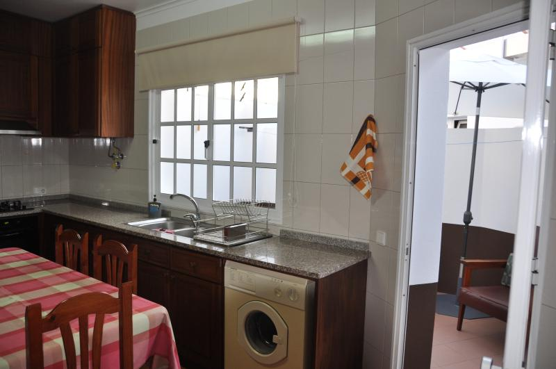 Kitchen with access to a covered area.