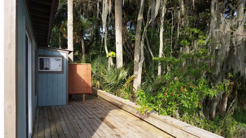 Runaway Bay The Blue Heron Waterfront 2 Bedroom View from private back patio. Outdoor shower & deck