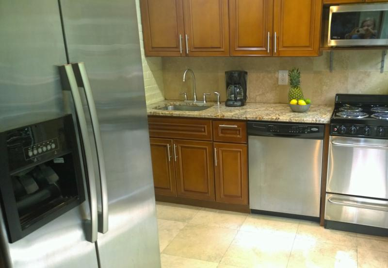 Prepare meals or snacks in the nicely equipped kitchen