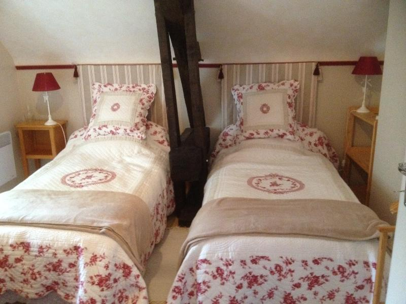 Upstairs twin-bedded room with en-suite shower-room.