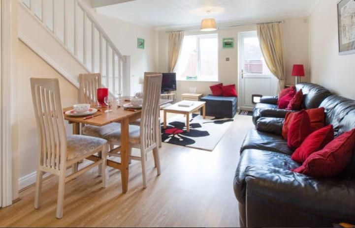 Open plan lounge/diner with single chair bed. TV with DVD player & Sky's FreeSat and IPod dock.