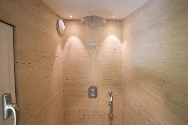 3rd Floor Walk-in Travertine Spa Shower with rainshower head/cascading faucet shared b 2 Queen rooms