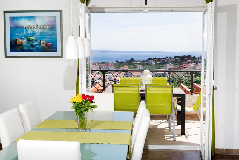 view from dining area to the balcony and sea view