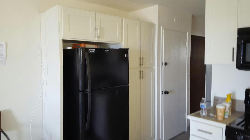 New refrigerator WITH  Ice Maker. Large pantry with complimentary pantry cooking items.