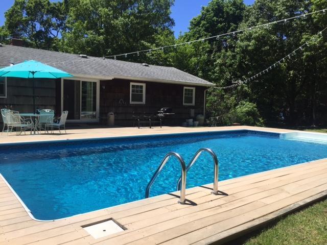 Inground pool w Trex decking. Ranges from 8 ft to 3 ft.