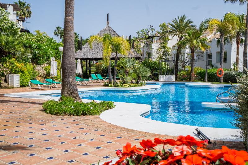 Large Tropical Pool Area with Complementary Sun Beds