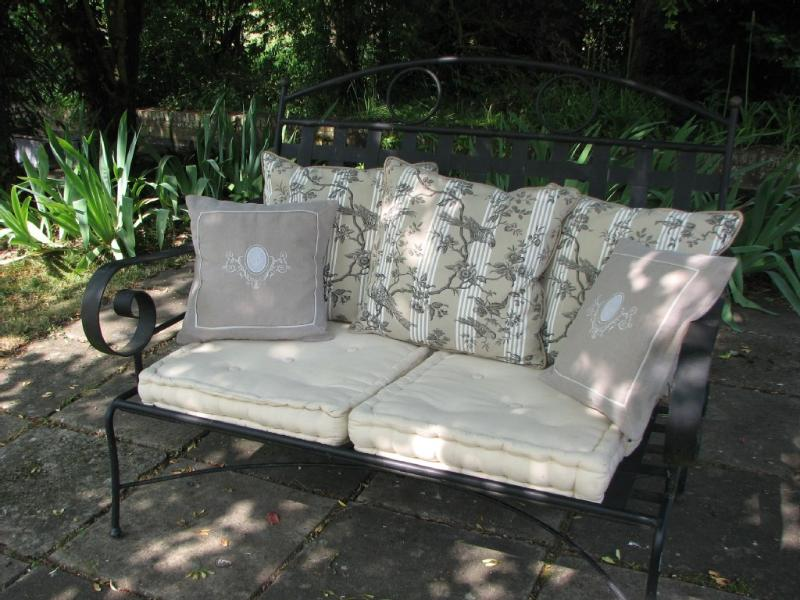 Iron sofa in the garden's sitting area