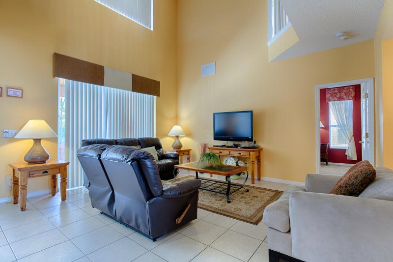 Family room with flat-screen TV and DVD player.