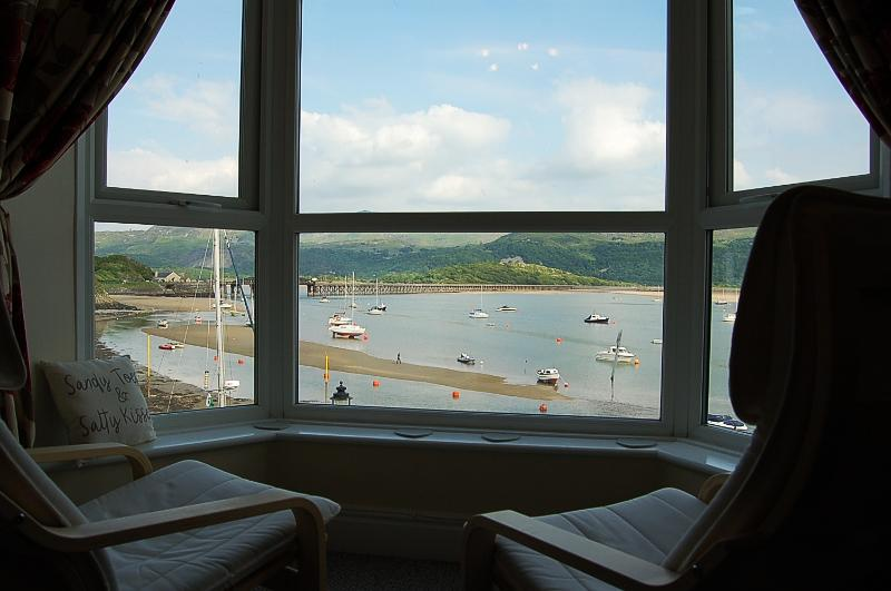 Enjoys spectacular views of Brunel's iconic  railway bridge, harbour and    the Mawddach Estuary