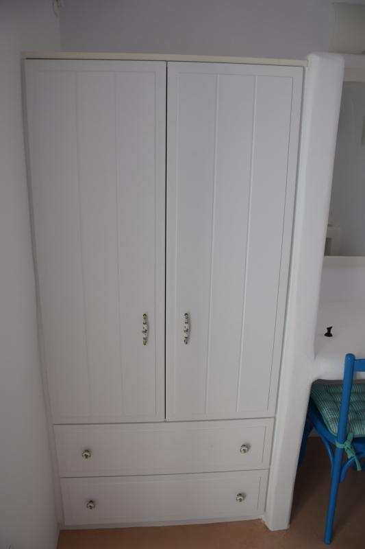 A large, wooden, built-in wardrobe