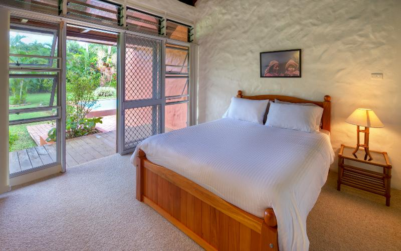 Second bedroom sleeps two with queen bed and separate bathroom with direct outdoor,pool access.