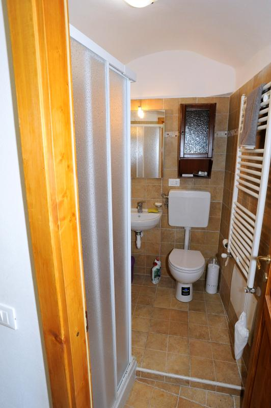 The toilet besides the living room