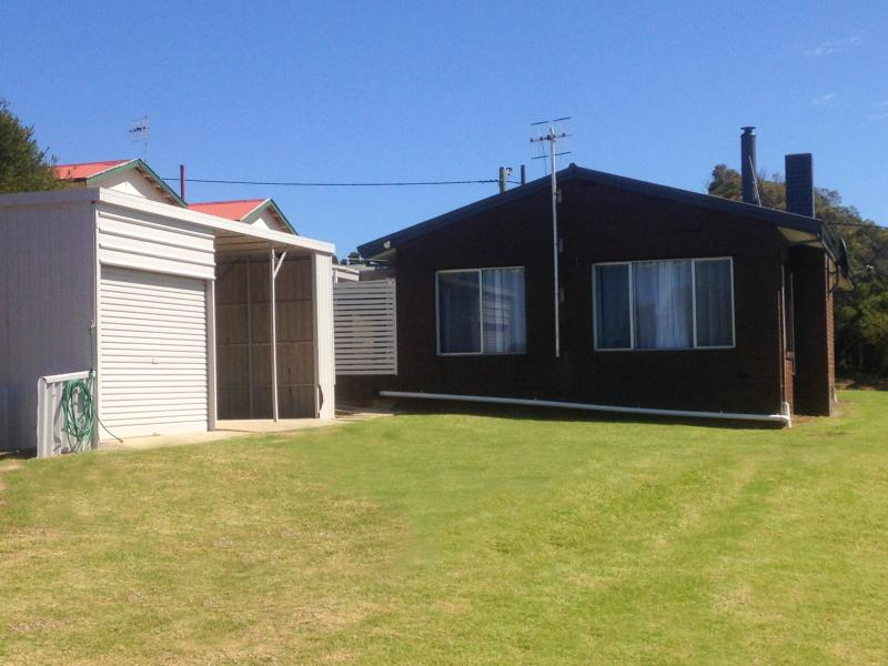 Plenty of room outside, large shed with BBQ, table and chairs.