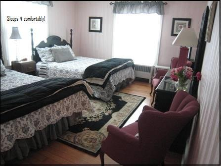 Beautifully decorated this large room with 2 queen size bed shares the hall bath  with 1 other room.