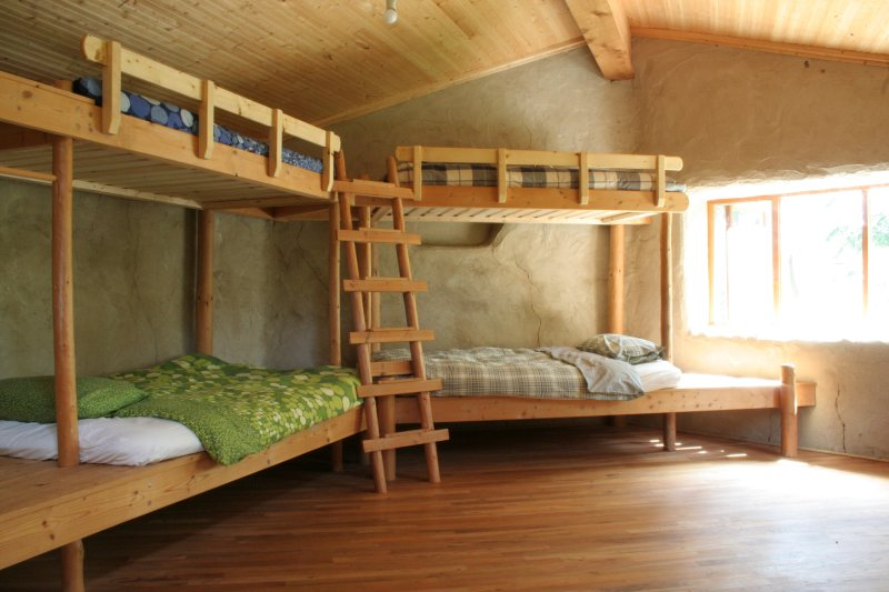 Spacious bedroom with 2 large rustic bunk beds.
